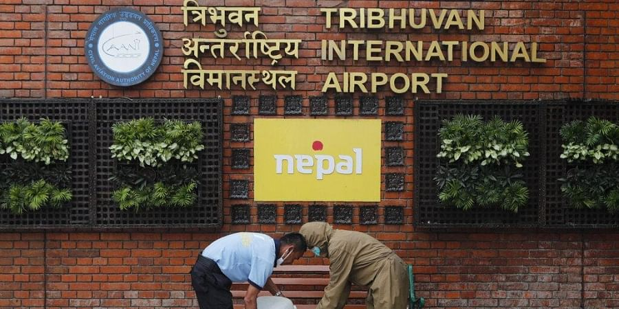 Officials prepare to disinfect the airport premises at Tribhuwan International Airport in Kathmandu, Nepal.