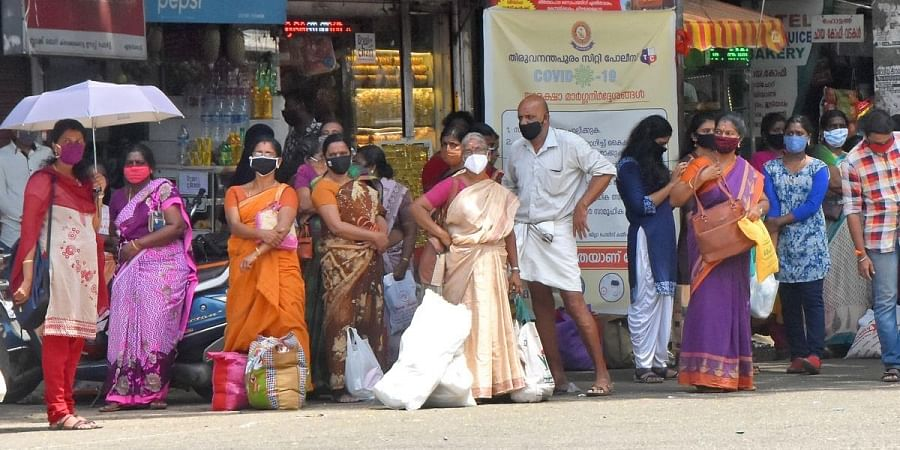 People waiting for the bus at the bus stop near Chalai market in Thiruvananthapuram
