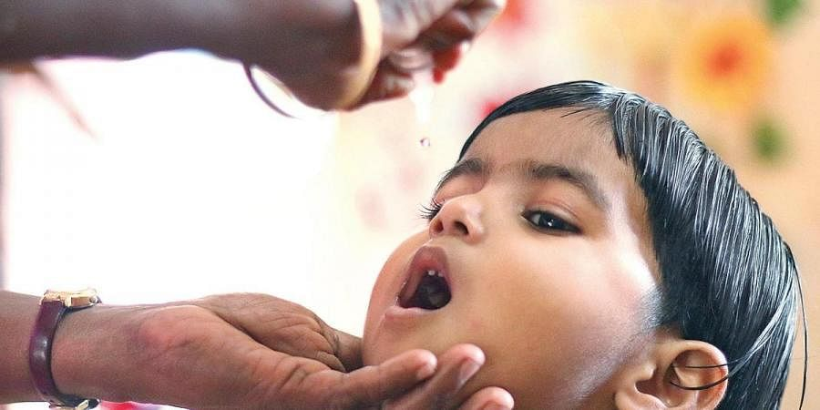 A child being administered pulse polio drops at a booth in Marutheri Anganwadi in Kozhikode on Sunday (File Photo | TP Sooraj, EPS)