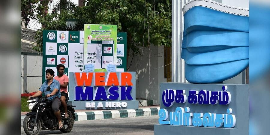 A mask model placed in front of Government medical college, Omandurar, in Chennai . (Photo | R Satish Babu, EPS)