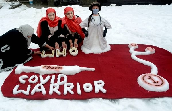 Sisters from Kashmir make snow sculpture as tribute to corona warriors