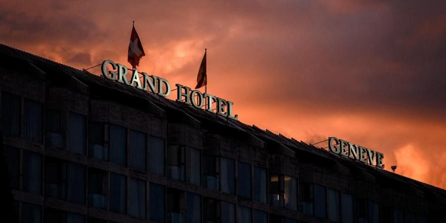 The sign of the Fairmont Grand Hotel Geneva after sunset as luxury Geneva hotels are facing 'life-threatening' corona crunch