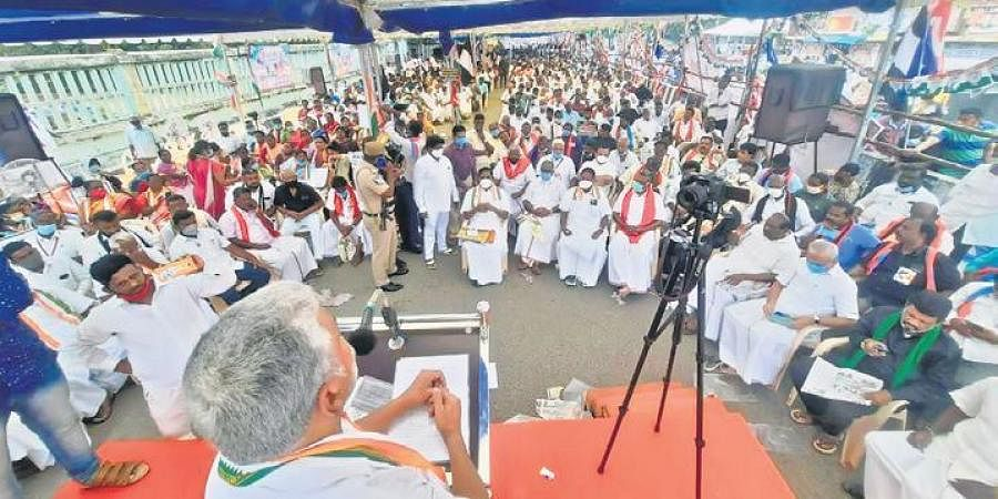 Agriculture Minister R Kamalakannan addressing the crowd at the dharna near Anna Statue Junction on Saturday   special arrangement