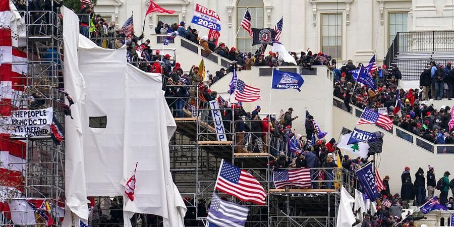 Trump supporters gather outside the Capitol. (Photo | AP)
