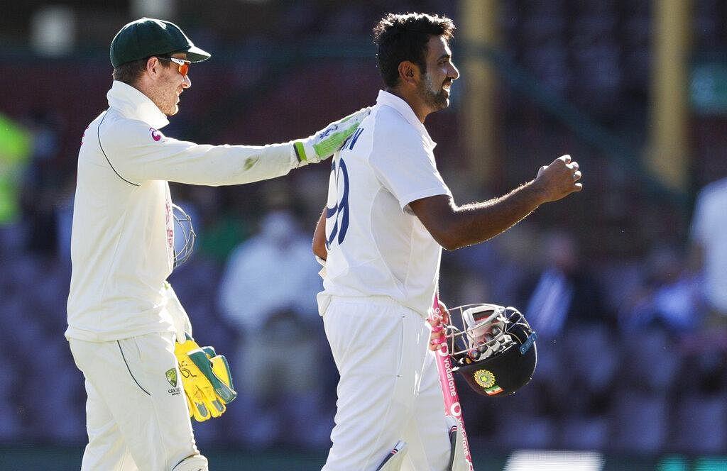 Australian captain Tim Paine, left, congratulates not out batsman India's Ravichandran Ashwin. (Photo | AP)