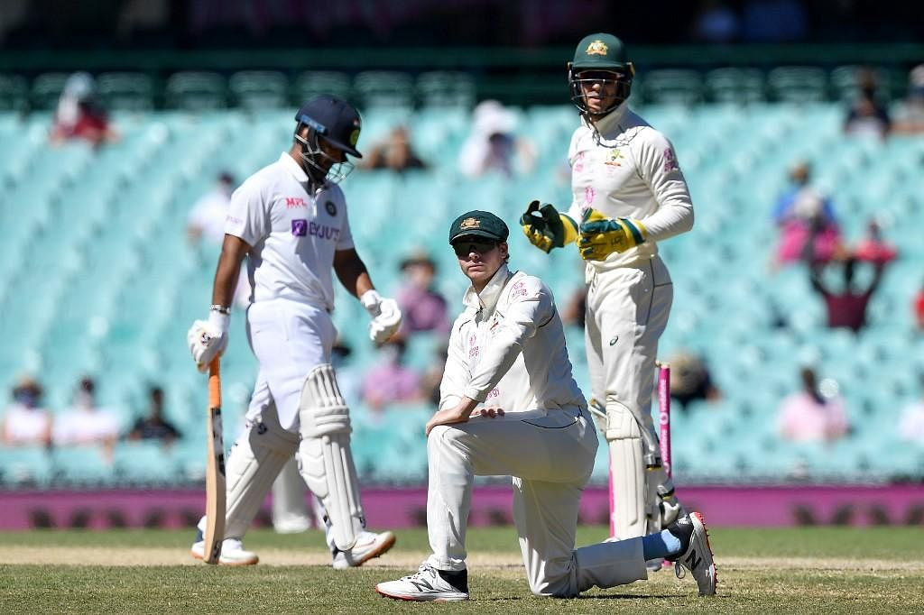 Steve Smith (C) of Australia looks on after a misfield during day five of the third cricket Test match between Australia and India. (Photo | AFP)