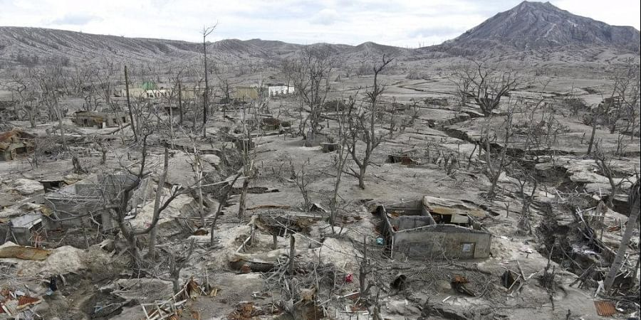 Damaged houses lie at Taal volcano almost a year after it erupted on Sunday, Jan. 10, 2021 in Batangas province, Philippines.