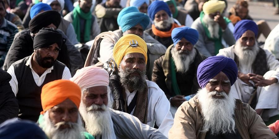 Farmers during their ongoing agitation against new farm laws at Ghazipur border in New Delhi.