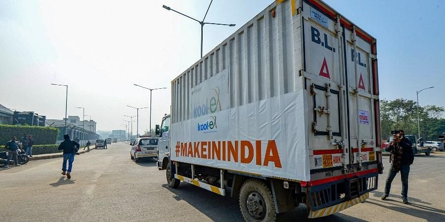 First consignment of Covishield vaccine dispatched from Pune's SII being transported in a temperature-controlled truck upon arrival at Delhi's IGI Airport on Tuesday