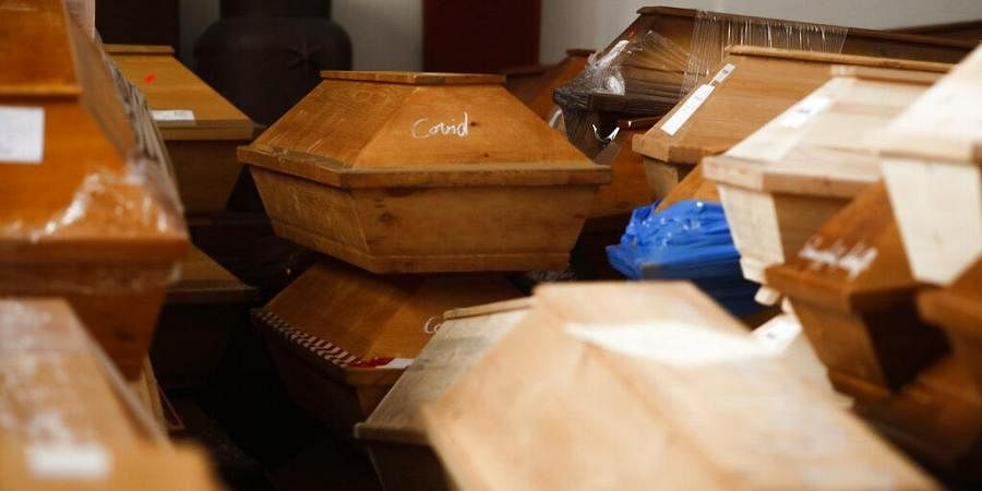 Coffins containing deceased people wait in the worship room of the crematorium in Meissen, Germany. (Photo|AP)