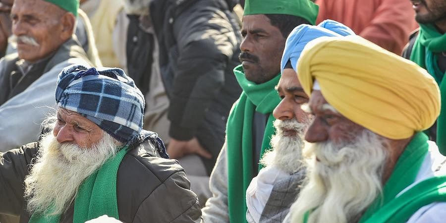 Farmers during their ongoing agitation against new farm laws at Ghazipur border in New Delhi Monday