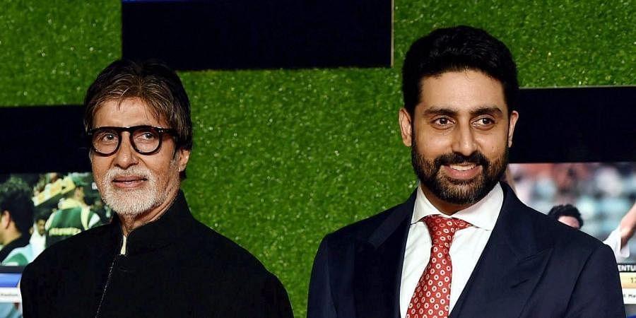 Bollywood star Amitabh Bachchan (L) with his actor son Abhishek Bachchan.