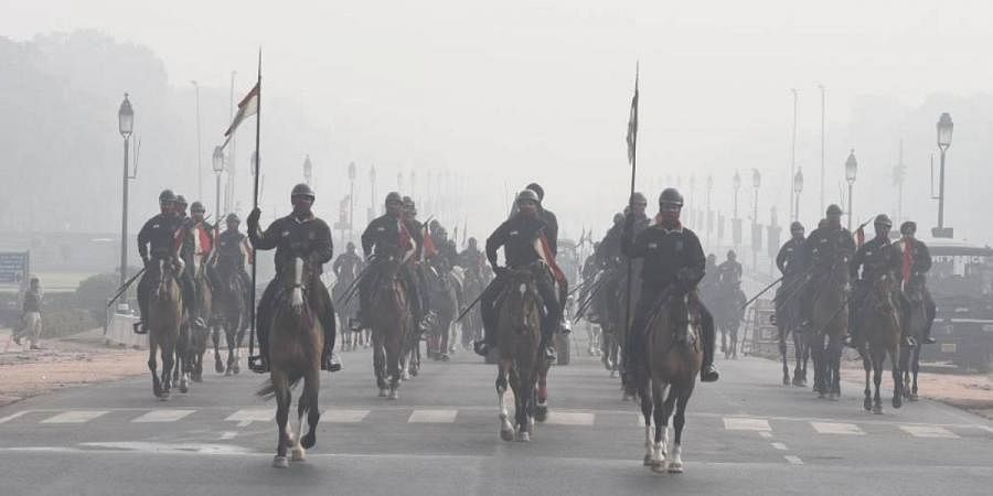 Indian Air Force personnel during the rehearsal for the upcoming Republic Day parade in foggy cold winter morning near India Gate