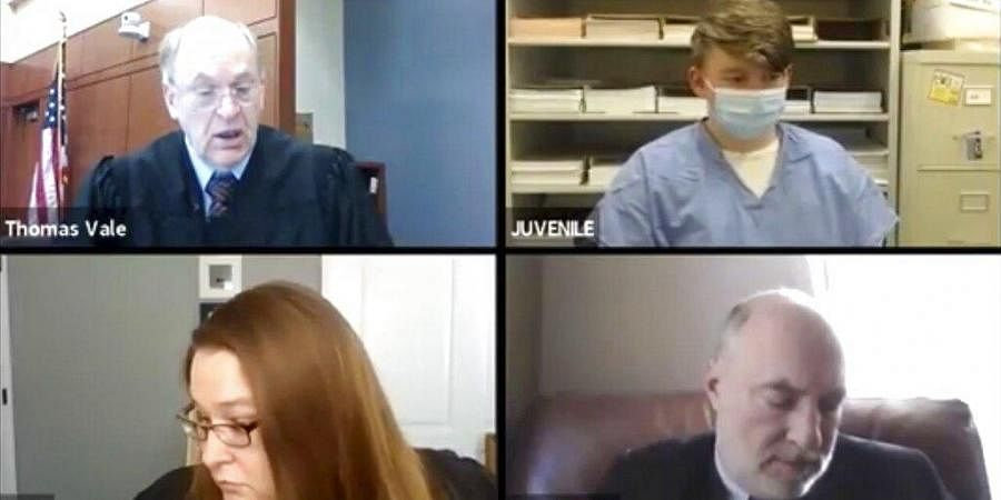 Logan T. Kruckenberg-Anderson, appears by video conference with Circuit Judge Thomas Vale, top left, Assistant District Attorney Laura Kohl and assistant state public defender Guy Taylor.