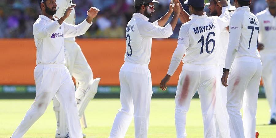 Thangarasu Natarajan, second right, is congratulated by teammates after dismissing of Australia's Marnus Labuschagne. (Photo | AP)