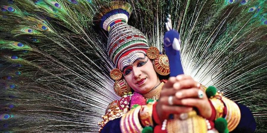 An artist performing peacock Mayooranritham a classical Kerala dance form in an event promoting Kerala tourism in Hyderabad