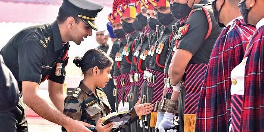 Dressed in an Army uniform, seven-year-old Nyorah Patra interacts with soldiers, on the 73rd Army Day, at Parade Ground in Secunderabad on Friday | S Senbagapandiyan