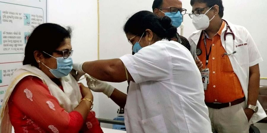 A frontline worker being administered COVID vaccine at MKCG Hospital in Berhampur. (Photo | Irfana, EPS)