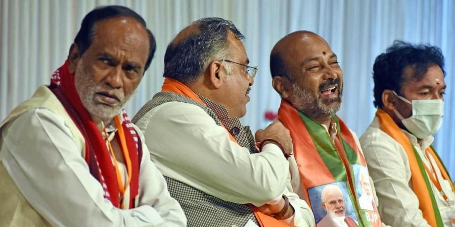(From L) Laxman Reddy, Tarun Chugh,BJP national general secretary, G Kishan Reddy, Union Minister of State for Home Affairs, Bandi Sanjay Kumar, BJP State president. (Photo | S Senbagapandiyan, EPS)