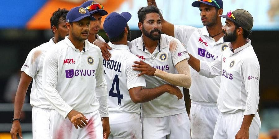 India's Mohammed Siraj, centre, is congratulated by teammates after taking his fifth wicket. (Photo | AP)
