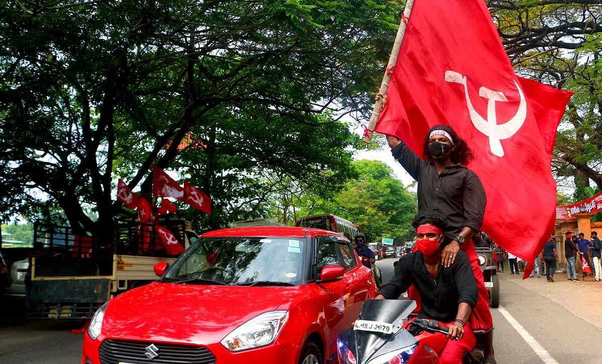 Party workers waving LDF flag while celebrating the victory in Kozhikode. (Photo | TP Sooraj, EPS)