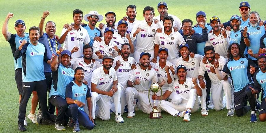 Indian players celebrate with their trophy after defeating Australia by three wickets on the final day of the fourth cricket test at the Gabba, Brisbane. (Photo | AP)