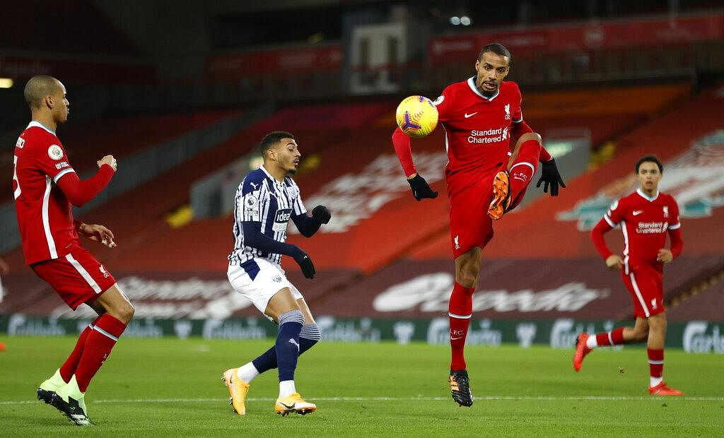 Liverpool's Joel Matip (third left) controls the ball during an English Premier League soccer match between Liverpool and West Bromwich Albion