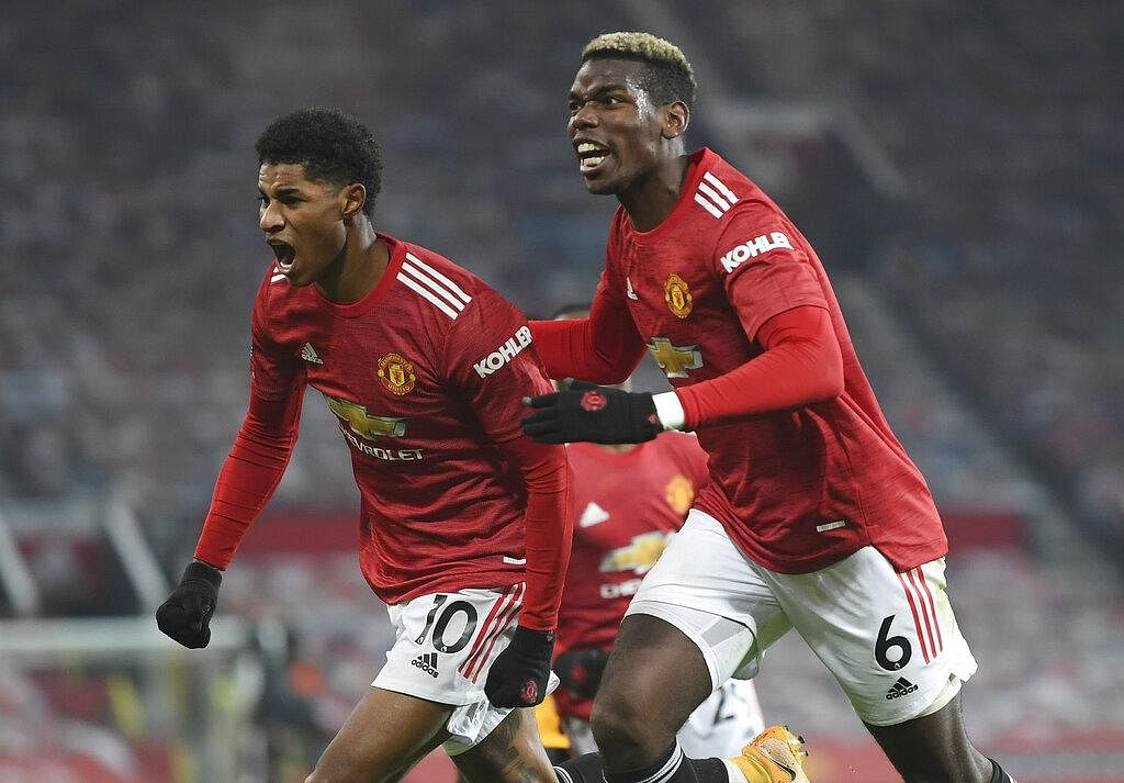 Manchester United's Marcus Rashford, left, celebrates with Paul Pogba after scoring the opening goal during the English Premier League soccer match. (Photo | AP)