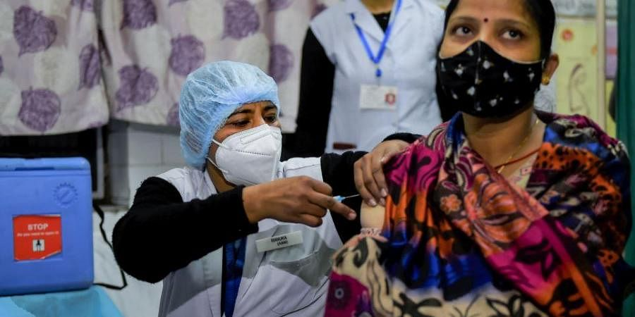 A health worker prepares for the dry run for the COVID-19 vaccine at a healthcare center