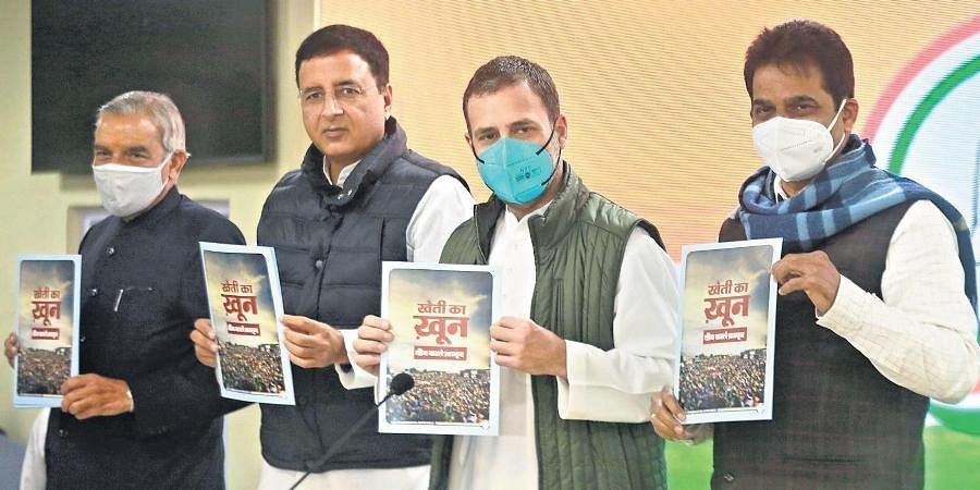 Congress leader Rahul Gandhi and other party leaders release a booklet on farmers' stir in New Delhi on Tuesday.
