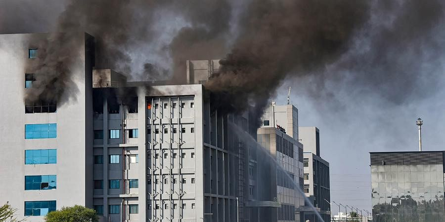 Smoke billows out after a massive fire broke out at the Serum Institute of India, in Pune. (Photo| PTI)