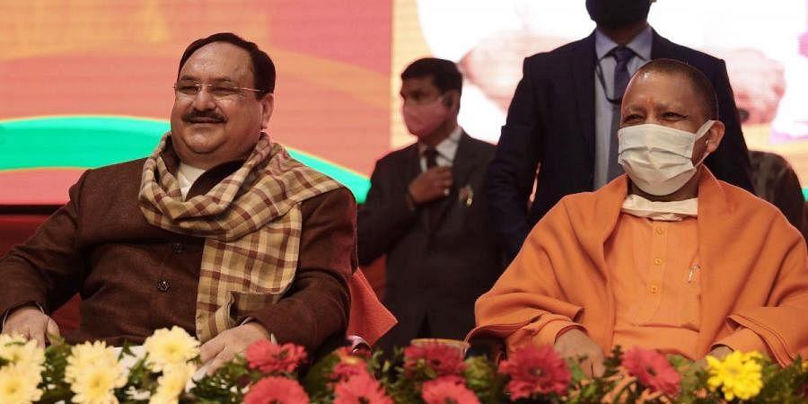 BJP national president JP Nadda (L) and Uttar Pradesh CM Yogi Adityanath