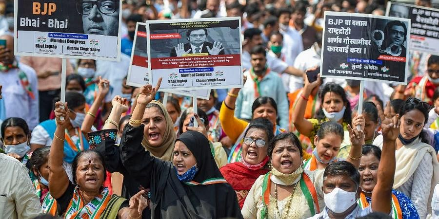 Congress supporters participate in a protest march against Republic TV Editor-in-chief Arnab Gosswami over his leaked WhatsApp chats