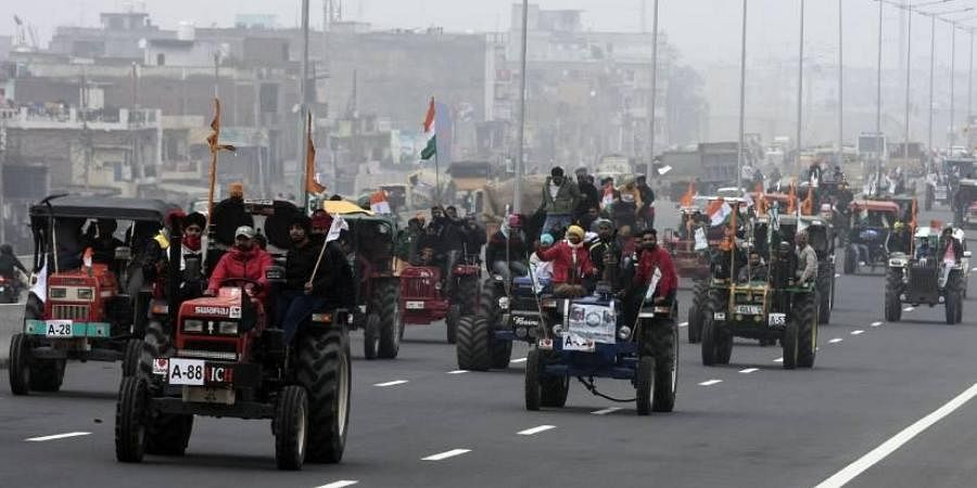 Farmers participating in a tractor rally on Delhi-Meerut Expressway on Thursday in a rehearsal for January 26 when they will move into Delhi.