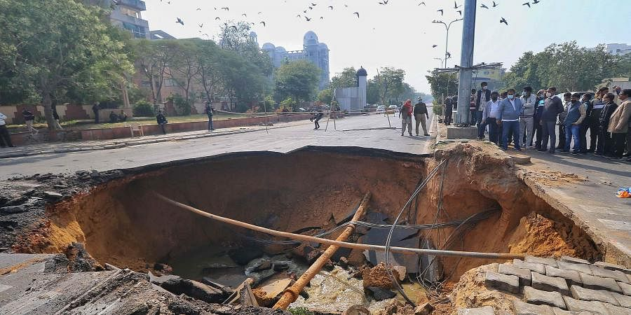 A sinkhole after a portion of a road collapsed at Chomu Circle, in Jaipur. (Photo| PTI)