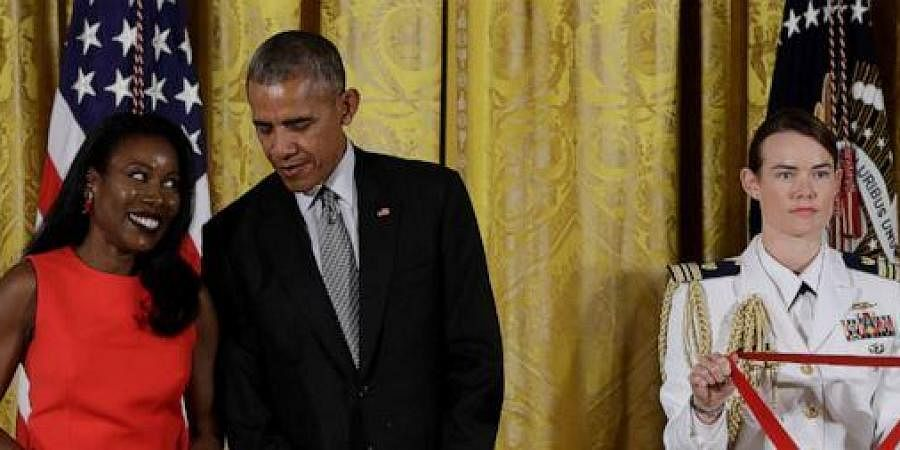 In this Sept. 22, 2016 file photo, President Barack Obama awards journalist and author, Isabel Wilkerson, the 2015 National Humanities Medal