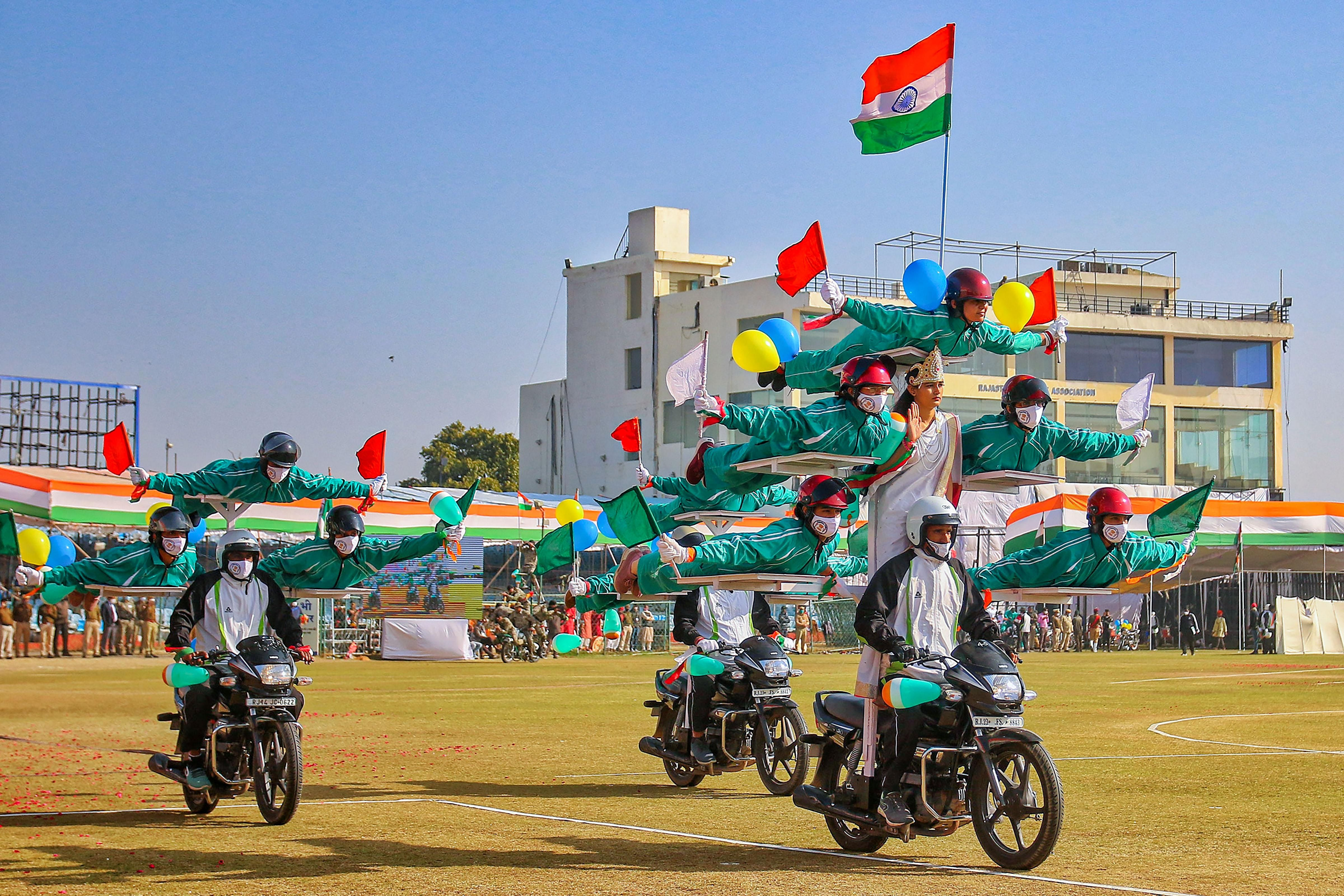 Rajasthan Police personnel perform daredevil stunts during the 72nd Republic Day celebrations at SMS Stadium in Jaipur.