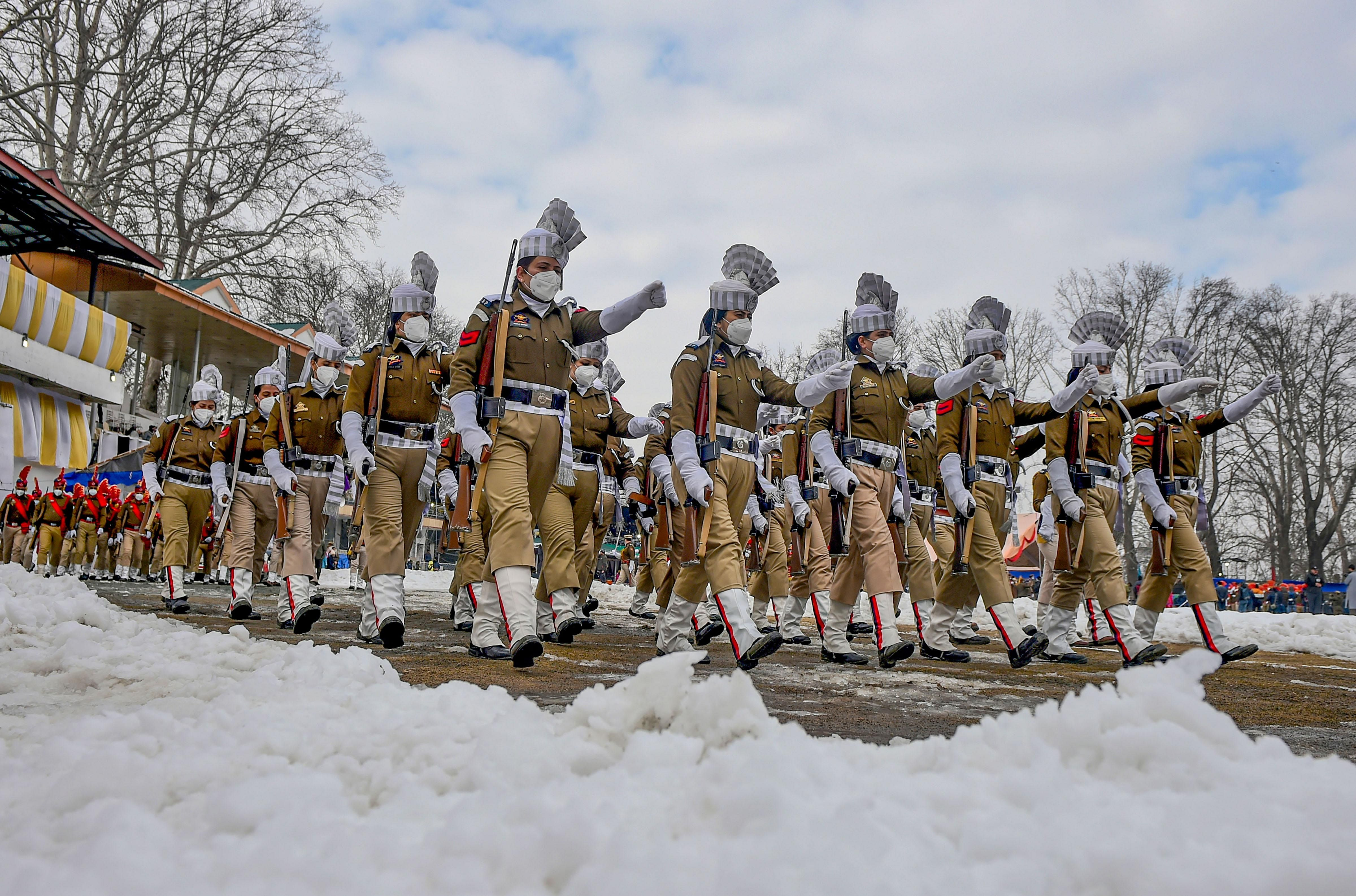 Women contingent of Indian Reserve Police (IRP) marches during the 72nd Republic Day parade at Sher-e-Kashmir Cricket Stadium, in Srinagar.