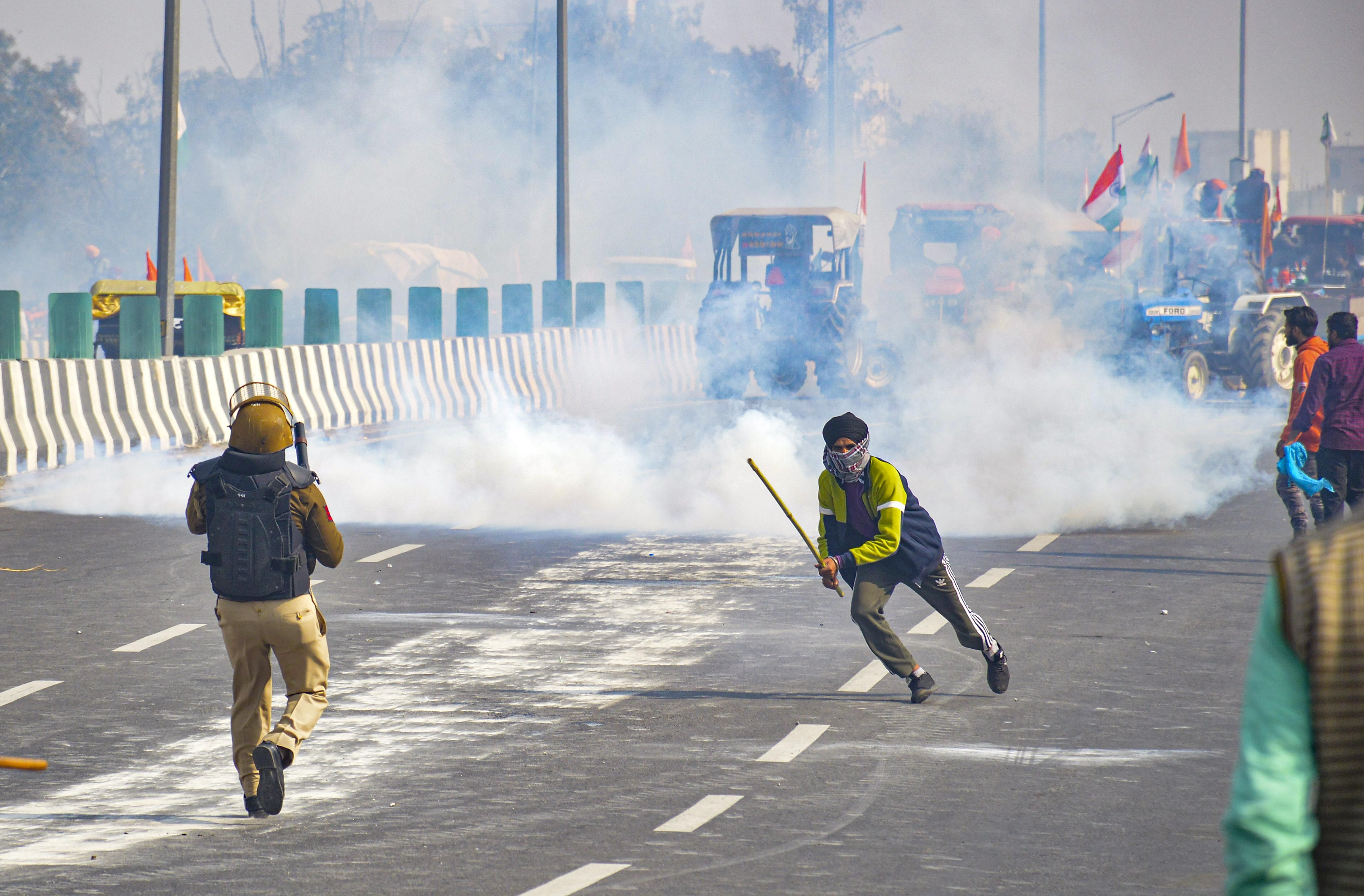 Police uses tear gas to disperse farmers attempting to break barricades as they try to march towards ISBT during the 'Kisan Gantantra Parade' amid the 72nd Republic Day celebrations, in New Delhi.