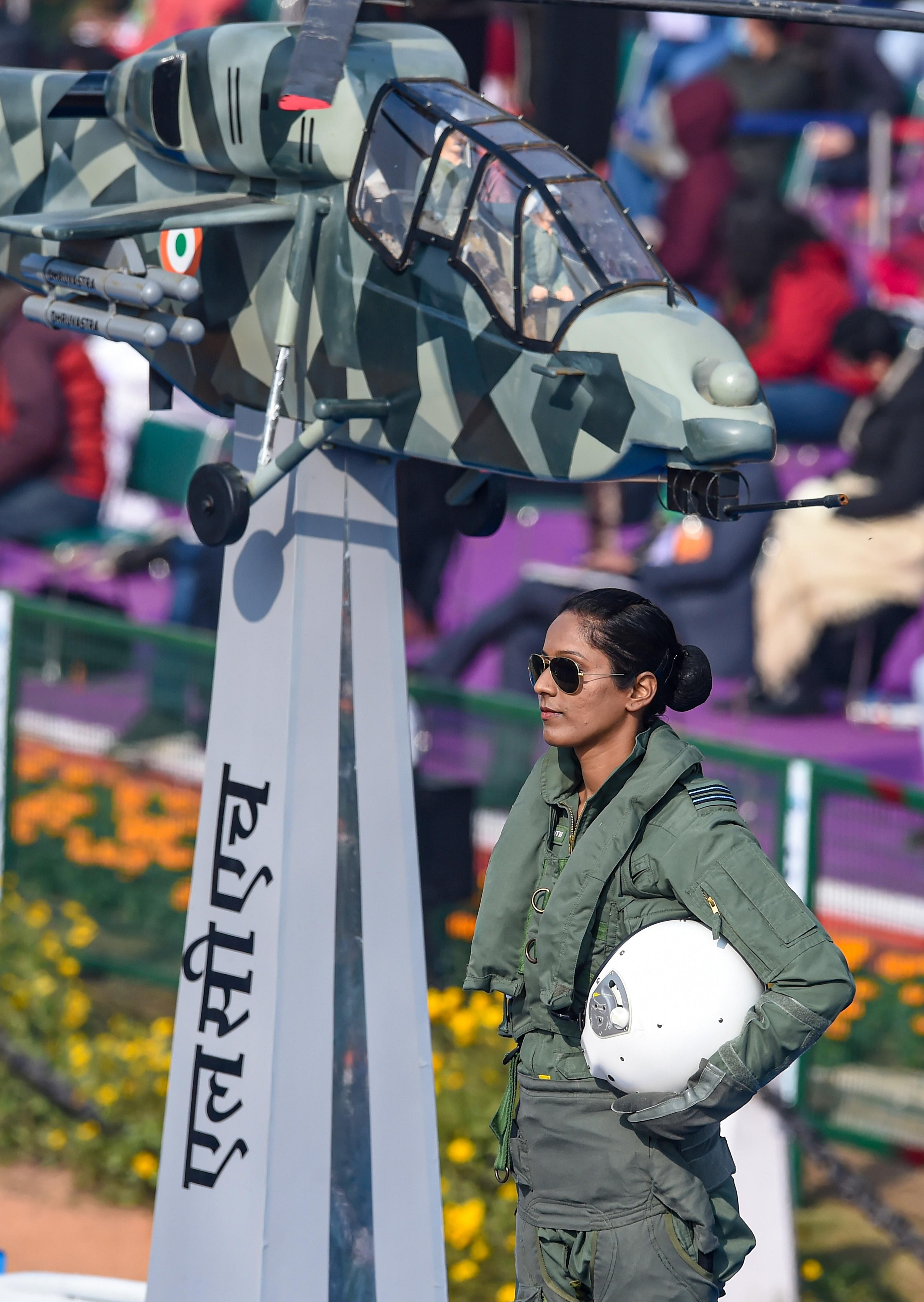 Flight lieutenant Bhawana Kanth stands on the Indian Air Force (IAF) tableau as it moves past Rajpath, during the 72nd Republic Day celebrations in New Delhi, Tuesday, Jan. 26, 2021. Kanth became the first woman fighter pilot to take part in the January 26 ceremonial event.