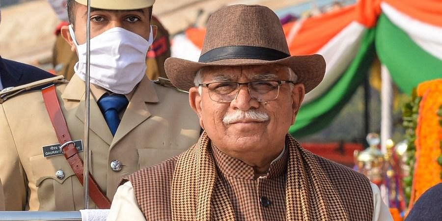 Haryana Chief Minister Manohar Lal inspects a guard of honor during the 72nd Republic Day celebrations in Panchkula