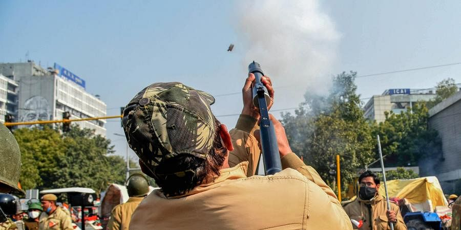 Police fire teargas shells to disperse protesting farmers who were attempting to break barricades at ITO during their 'tractor march' on Republic Day