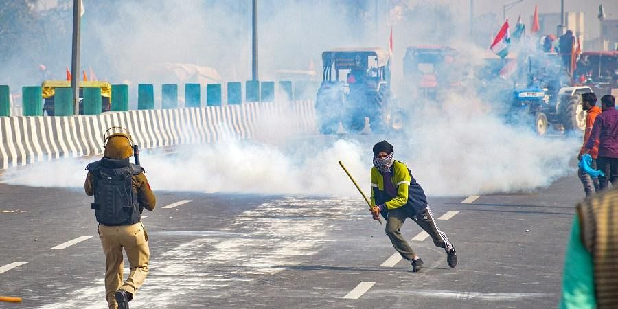 Police fires teargas shells as farmers attempt to march towards Delhi during the 'Kisan Gantantra Parade' amid the 72nd Republic Day celebrations at Akshardham