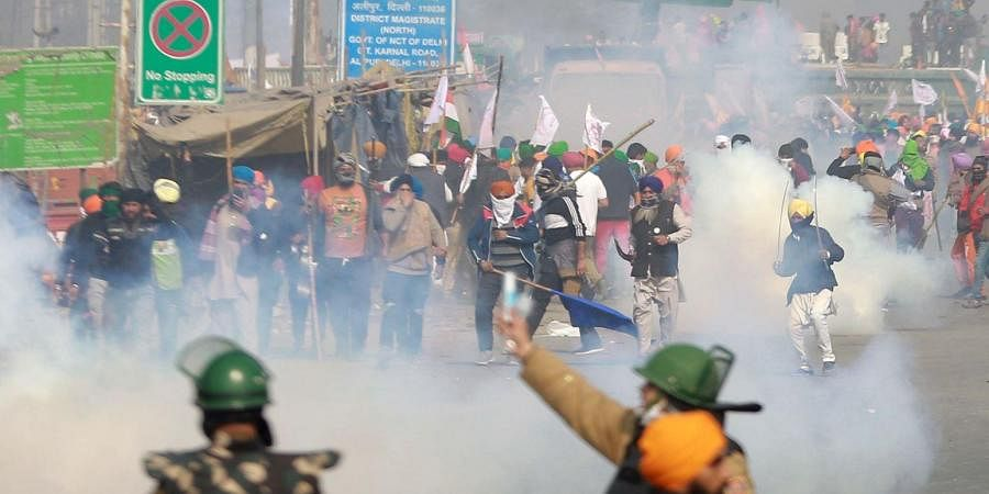 Police uses tear gas to disperse farmers attempting to break barricades at Ghazipur border during their Kisan Gantantra Parade on the occasion of 72nd Republic Day. (Photo | Shekhar Yadav, EPS)