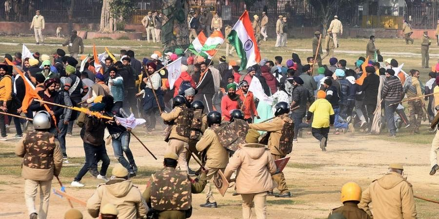 Police chase away protesters and farmers who had reached the Red Fort after the Republic Day parade in Delhi on Tuesday. (Photo | Parveen Negi, EPS)
