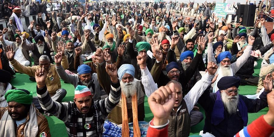 Farmers shout slogans during their protest against the new farm laws at the Delhi-UP border.