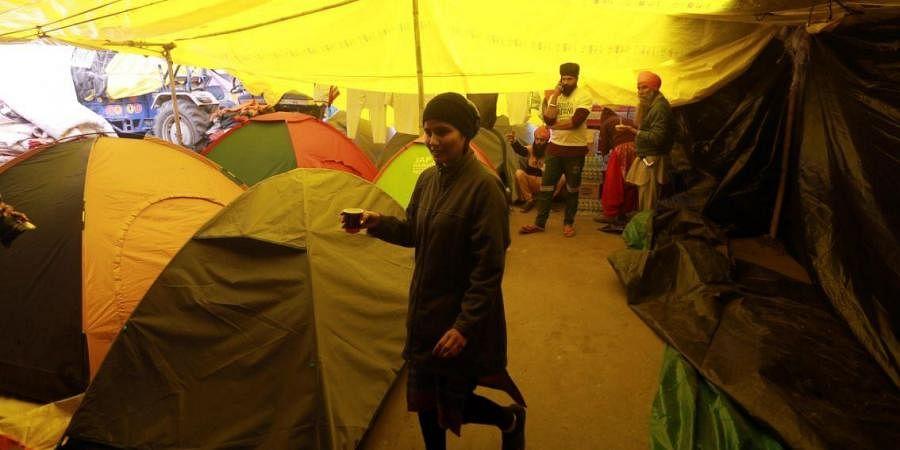Farmers during their agitation against new farm laws at Singhu border in New Delhi