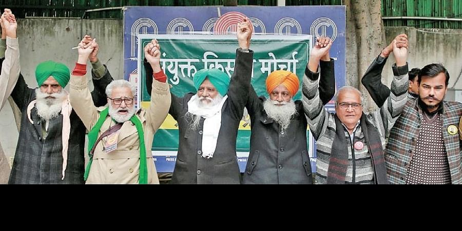 Members of the farmers' unions present a united face at a press conference in New Delhi on Saturday.