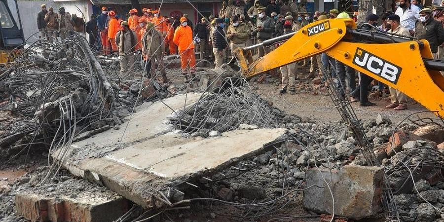 Rescue operation carried out by NDRF personnel after the complex roof of a crematorium collapsed due to heavy rain.