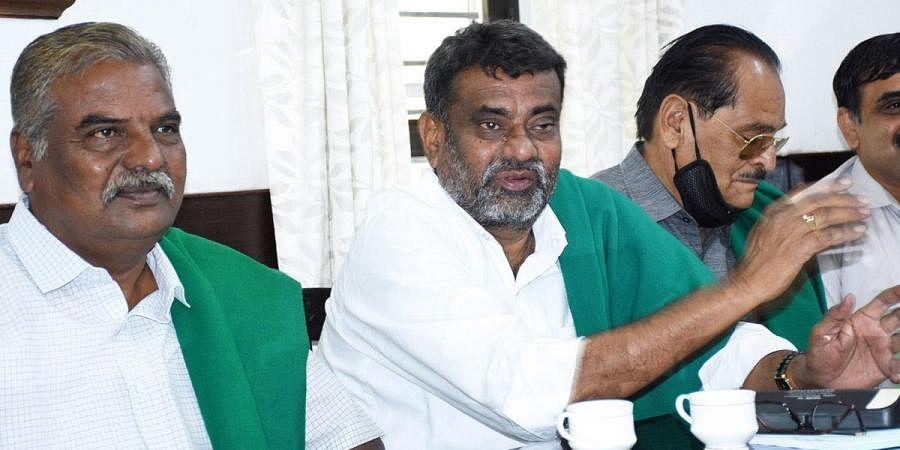 Farmer leader Badagalapura Nagendra and Chamrasa Malli Patil (left) at a press meet in Mysuru. (Photo   Udayshankar S, EPS)